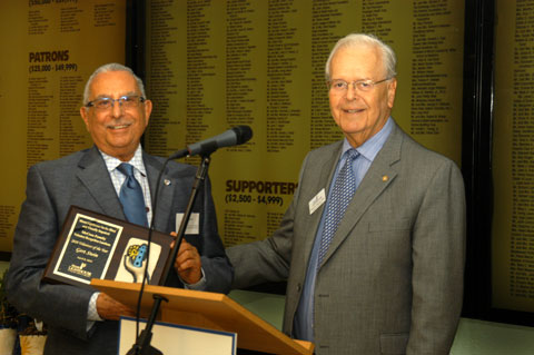 Gert Stein is presented Volunteer of the Year Award by Chairman Owen Freed.