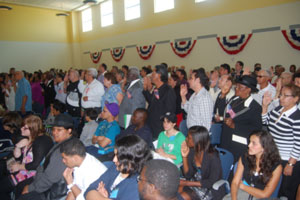 Miami Lighthouse performers watch as citizens are sworn in