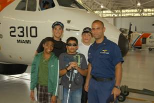 Coast Guard member Heredia with students.