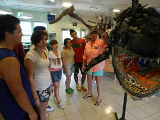 Music students learn about the hazards of liter from this shark made from garbage found on the beach.