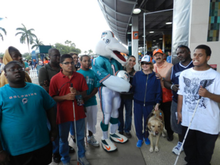 Miami Lighthouse students stand with Dolphins mascot T.D.