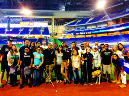 Transition students on the field with Miami Marlins Catcher Rob Brantly