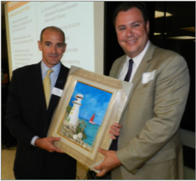 Chairman of the Board Agustin Arellano, Jr. presenting Jose Gonzalez, All Aboard Florida, with a tactile painting made by Social Group Activities