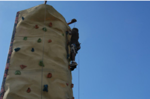 Miami Lighthouse summer camper rock climbing