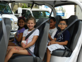 Miami Lighthouse summer campers enjoying a golf cart ride