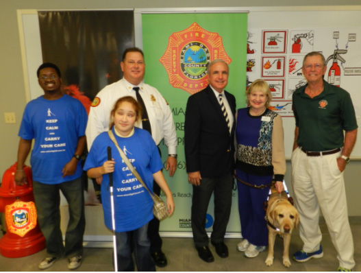 Miami Lighthouse summer camp students, Miami-Dade Fire Rescue Chief David Downey, Miami-Dade County Mayor Carlos Gimenez, Miami Lighthouse President & CEO Virginia Jacko, Former Fire Chief Ed Donaldson
