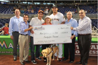 PJ Loyello Senior VP of Communications & Broadcasting, David Samson Miami Marlins President, Board Chair Agustin Arellano Jr., President & CEO Virginia Jacko, Miami Marlins Outfielder Giancarlo Stanton, Honorary Board Director Ray Casas and Alfredo Mesa Executive Director of Miami Marlins Foundation.