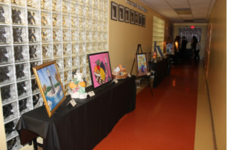 Artwork by Social Group Activities participants on display.