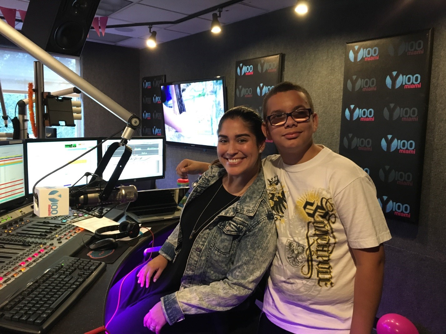 Pre-Employment Transition student Christian with Michelle Fay during a visit to Y100 Miami