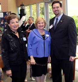 Board Director Gloria Martin with CEO Virginia Jacko and Representative Jose Felix Diaz.