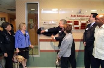 Board Director Ray Casas unveils the plaque with (from left to right) Board Director Gloria Martin, CEO Virginia Jacko, Senator Nan Rich, Representative Jose Felix Diaz and Senator Oscar Braynon.