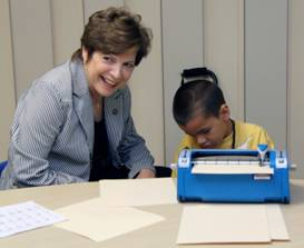Senator Nan Rich visits the STAR summer camp program Braille literacy class.