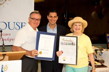 Florida State Representative Luis Garcia and City of Miami Commissioner Francis Suarez present President and CEO Virginia Jacko with Proclamations commemorating October 14th 2011 as White Cane Day