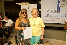 CEO Virginia Jacko with Luz Marina Rosenfeld, Top Pledge Winner