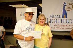 CEO Virginia Jacko with Hugo Meneses, Pledge Winner runner-up