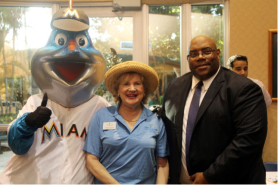 Billy the Marlin, CEO Virginia Jacko and Julius Davis, District Administrator, Division of Blind Services