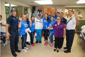 Representatives from Florida Blue and City of Miami Department of Fire Rescue with Grand Marshall Billy the Marlin.